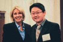 Secretary DeVos (L) with USABO 2017 <br>Finalist Wenbo Wu.